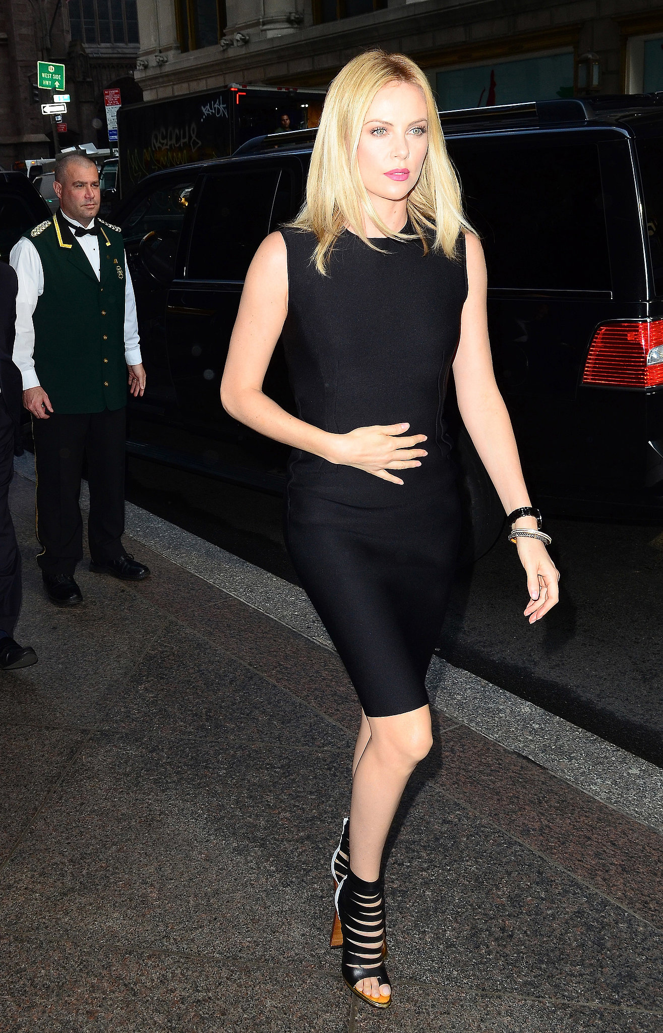 Charlize was spotted in NYC, sporting a form-fitted black Lanvin sheath and strappy Christian Louboutin sandals.
