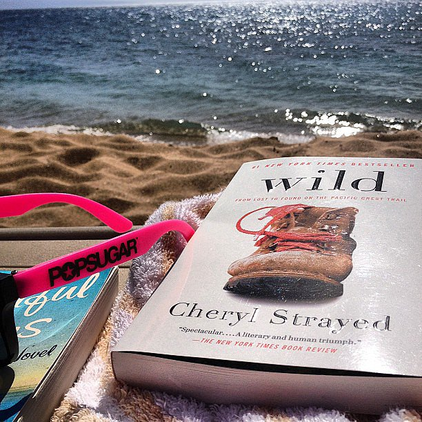 "POPSUGAR Entertainment editor shannonvestal took a sandy reading break, writing, ""Beach reading day with my POPSUGAR shades."""