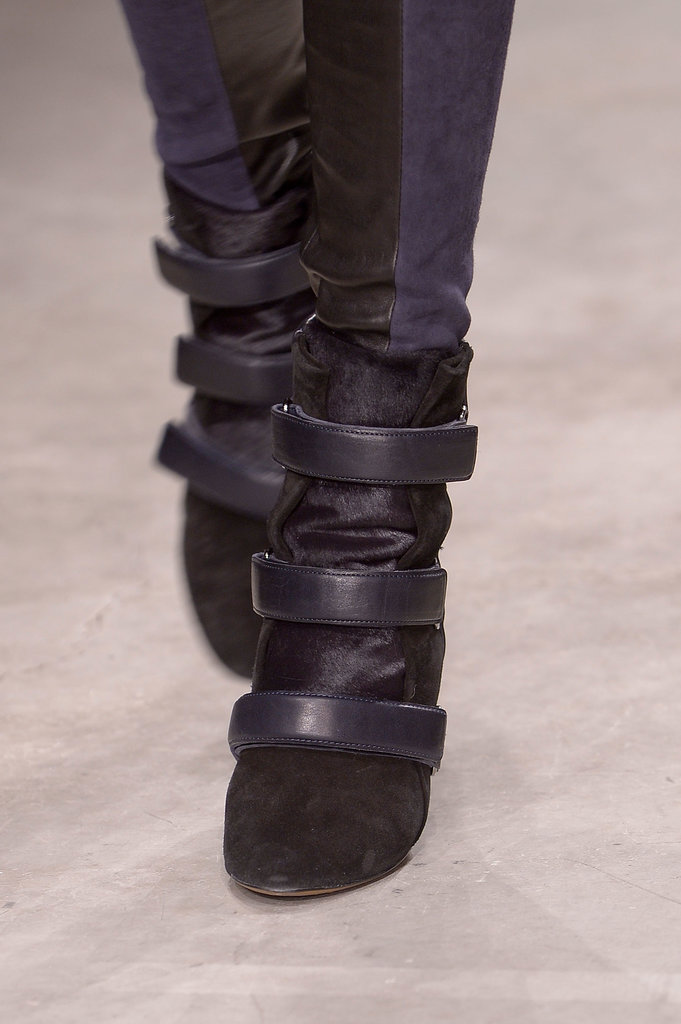 Examined from this angle, we see shape similarities with Marant's seen-everywhere wedge sneaker, including a top section that looks like the sportier style's puffed-up tongue.