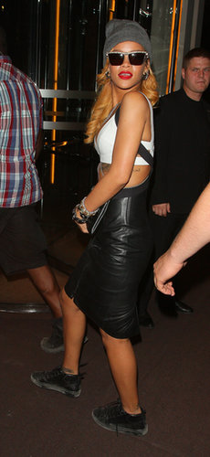 In London, the singer added a sleek white crop top to a leather Gareth Pugh suspender skirt, then finished it off with black high-tops, shades, and a beanie.