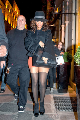 Tempering her orange miniskirt and scalloped kneesocks with a bell-sleeve coat and fedora, the brunette beauty showcased yet another fashion-forward street style while strolling around Paris in October 2011.