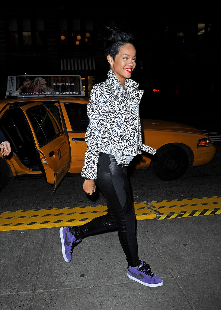 The brunette stunner proved the power of a statement shoe rocking purple suede Nikes with her swirled black and white jacket in NYC.