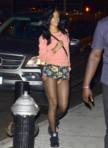 Rihanna topped her punchy sweater and floral Topshop shorts with a mini Céline crossbody while arriving to her NYC hotel in May 2012.