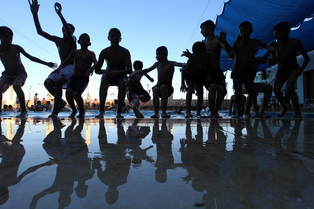 Palestinian little ones went swimming in Hawara a day after the Eid al-Fitr celebrations.