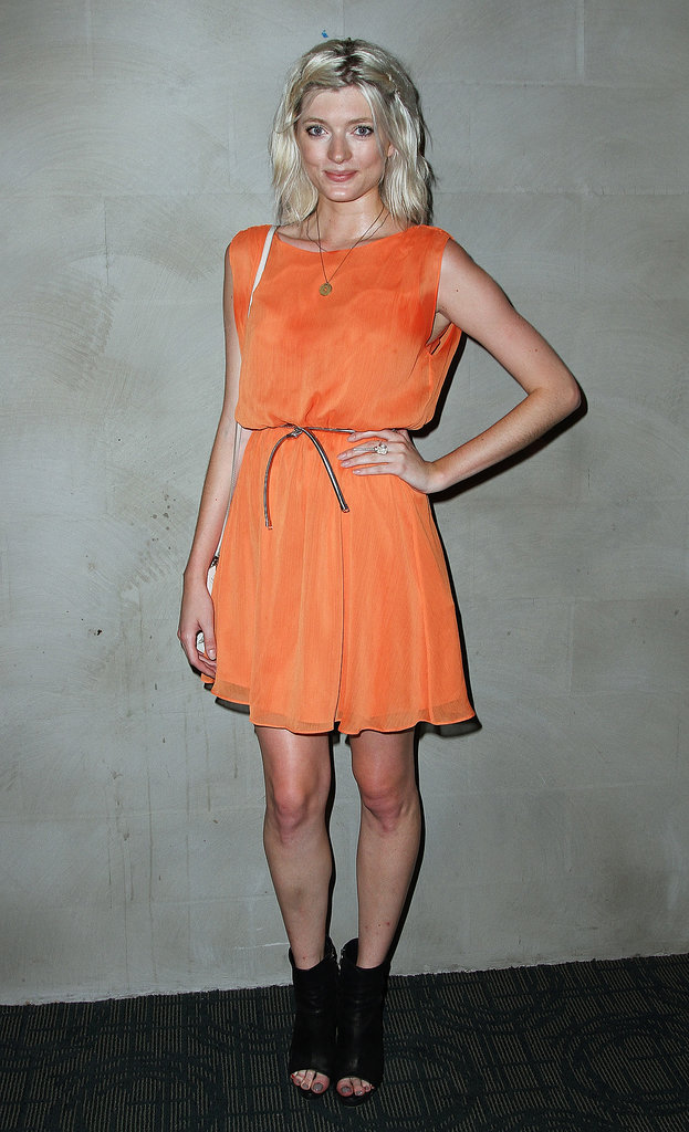 Sophie Sumner brightened up the room in an orange dress at Alice + Olivia's Austenland screening.