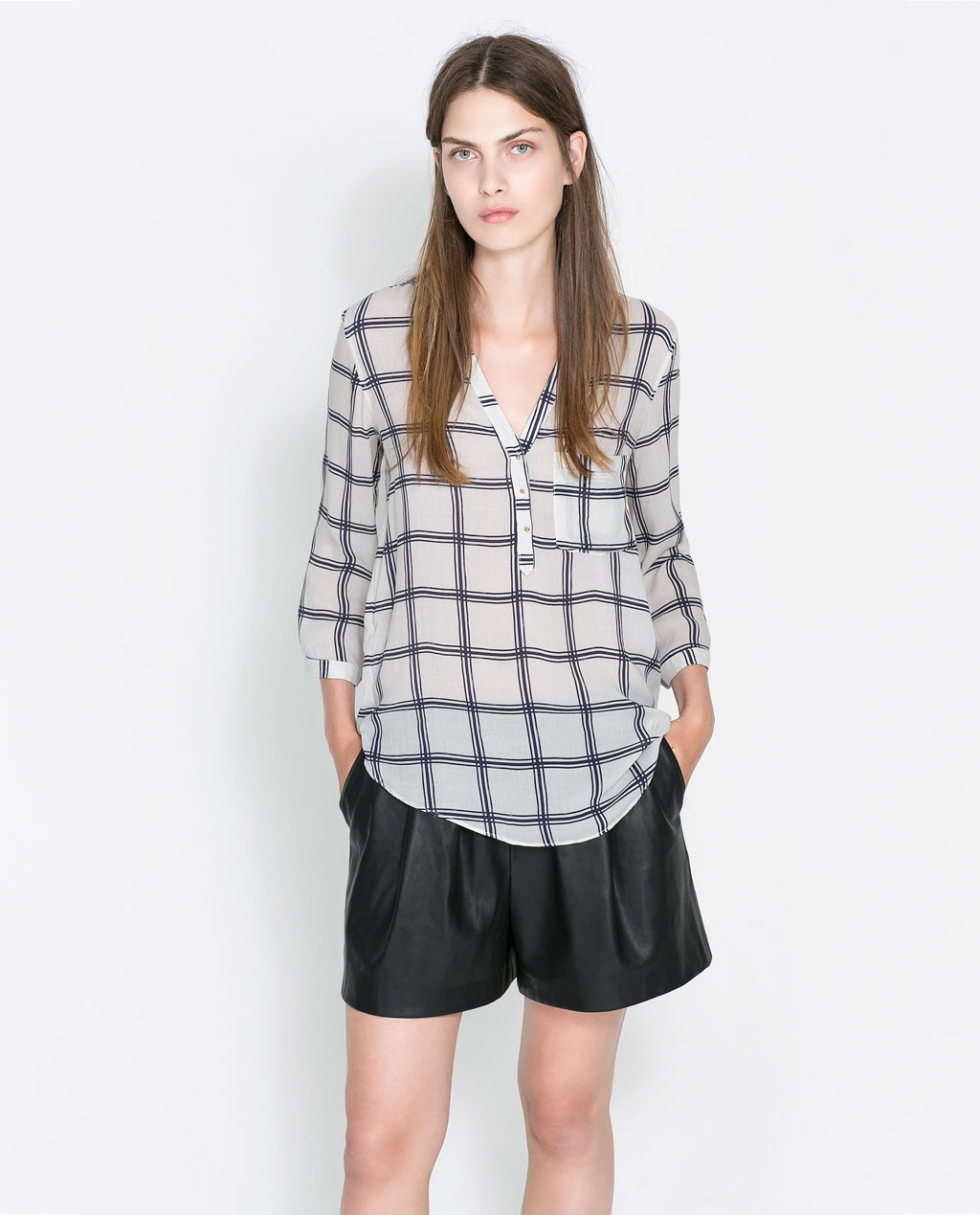 With white jeans or leather shorts, this Zara check-print blouse ($50) would be perfect.