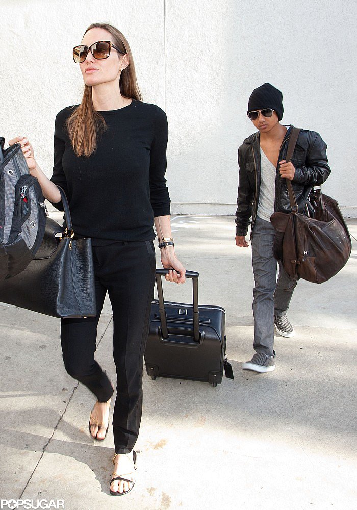 Angelina Jolie walked with Maddox out of the airport.