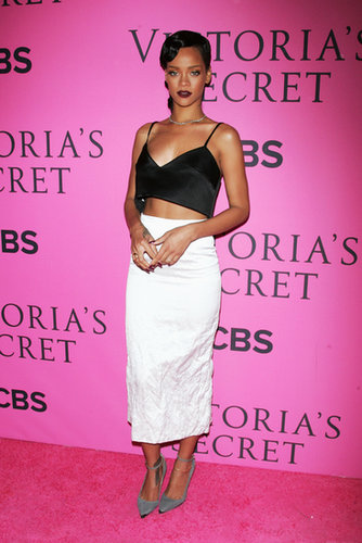 Rihanna tempered her skin-baring satin bralette with a crinkled pencil skirt, both by Miu Miu, while arriving at the Victoria's Secret Fashion Show in November 2012.