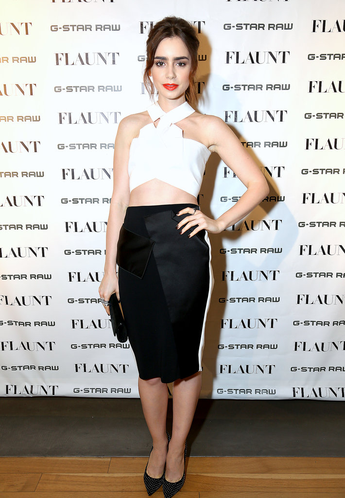 Lily Collins ramped up the sex appeal in a geometric white top by Roland Mouret, paired with a sleek body-con skirt.