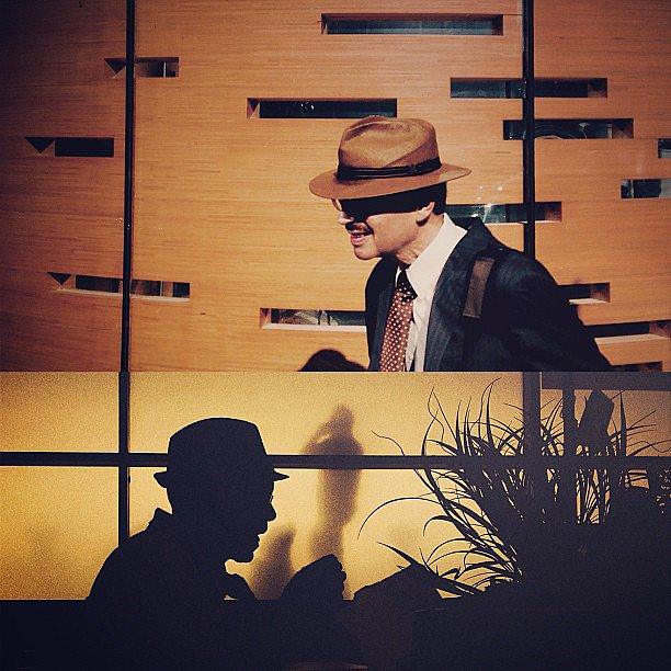 A man in a brimmed hat is a recurring theme in Richard's work. Source: Instagram user koci_glass