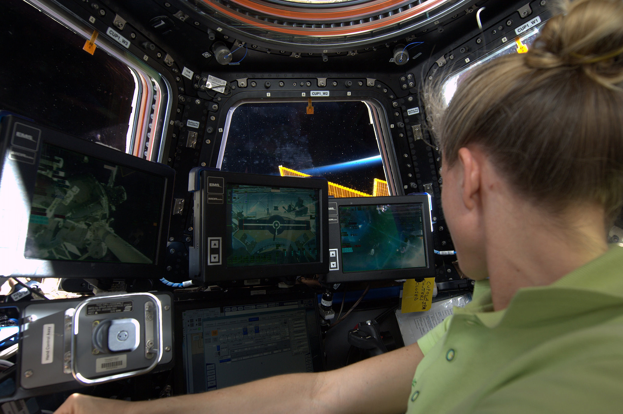 """At the Robotics Work Station in the Cupola. This is where we'll be to capture #HTV4 cargo vehicle with #Canadarm2 on Friday, August 9. My incentive: garlic paste and a care package from home! KN from space."" Source: Pinterest user Karen Nyberg"
