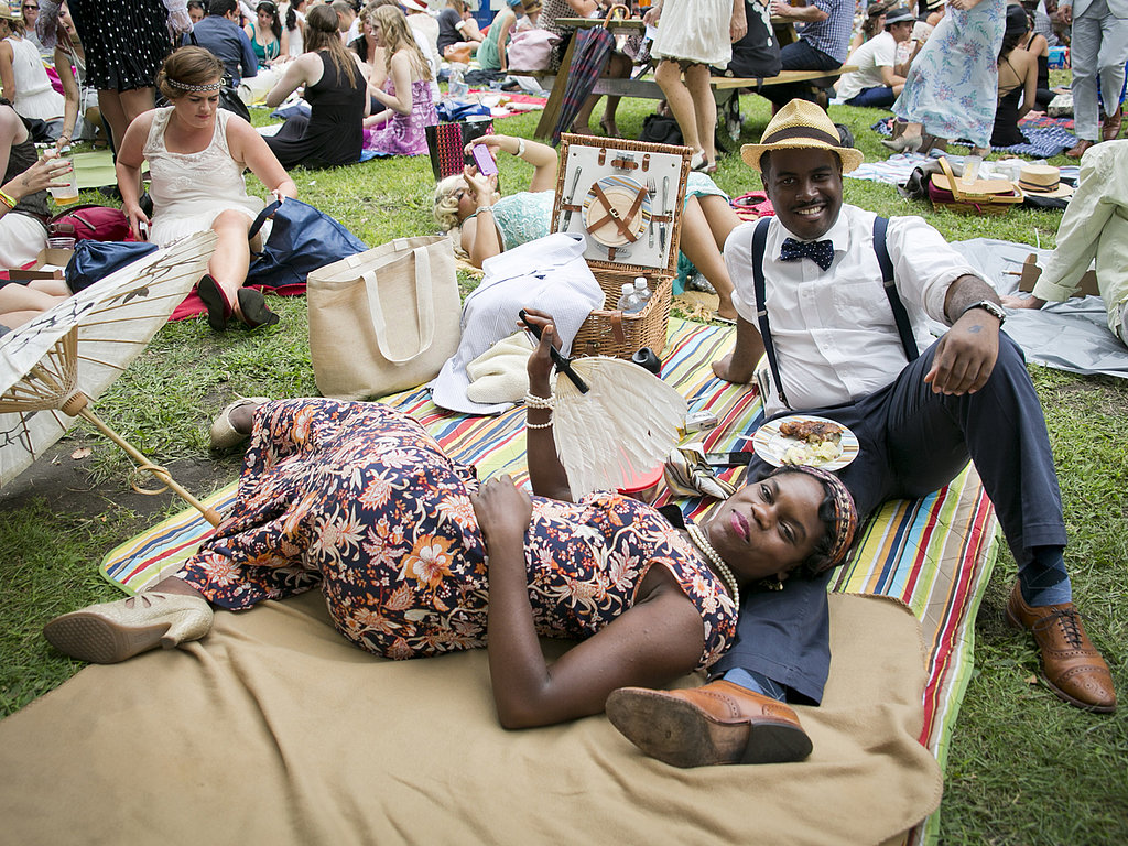 A tuckered-out couple relaxed in a printed dress and bow tie. Good thinking on the fan! Photo: Whitney Browne
