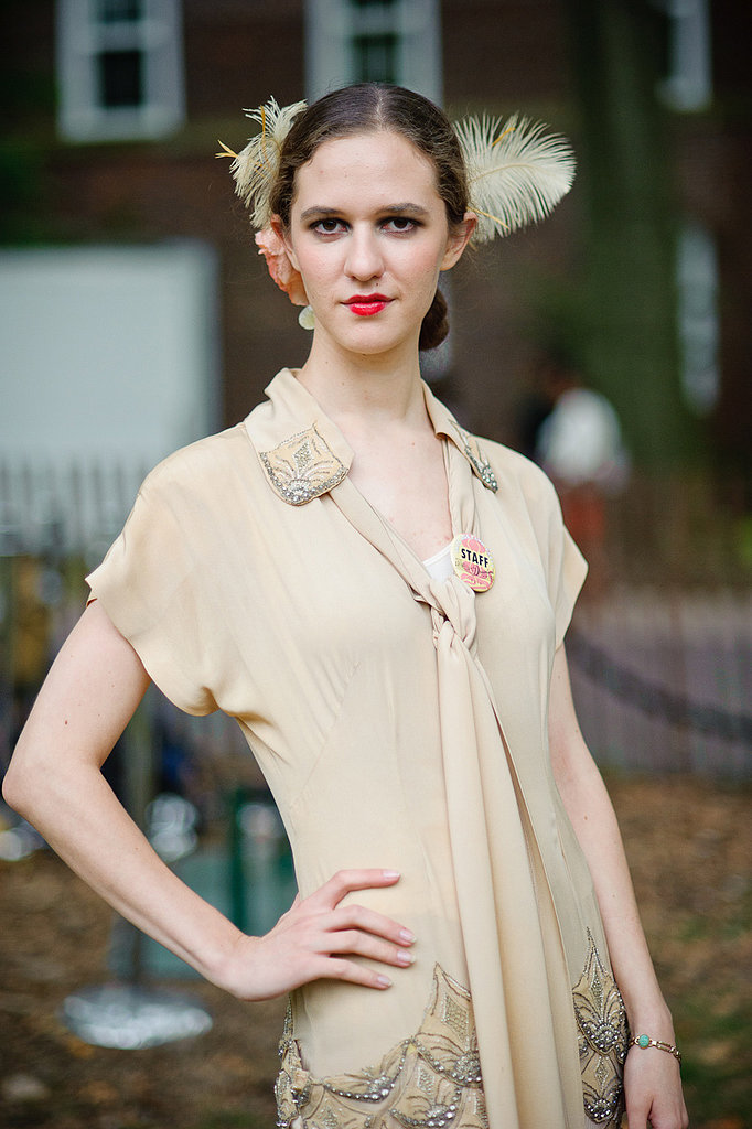 The deco embellishments and tie neck of this frock would look chic worn in your most modern of occasions. We love the final flourish of the feather! And that bold red lip! Photo: Jane Kratochvil