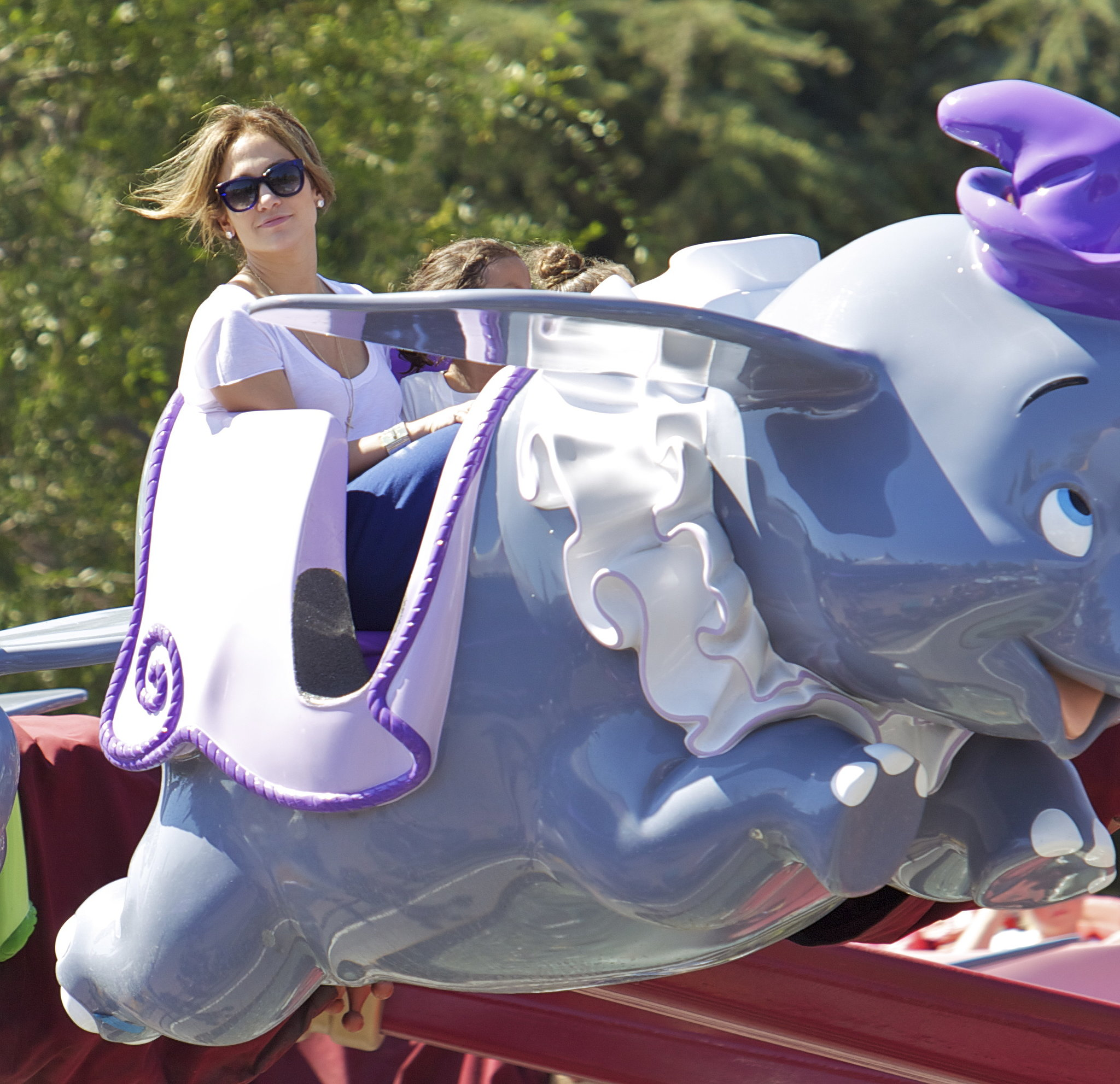Jennifer Lopez sat with her daughter, Emme, on a ride at Disneyland.