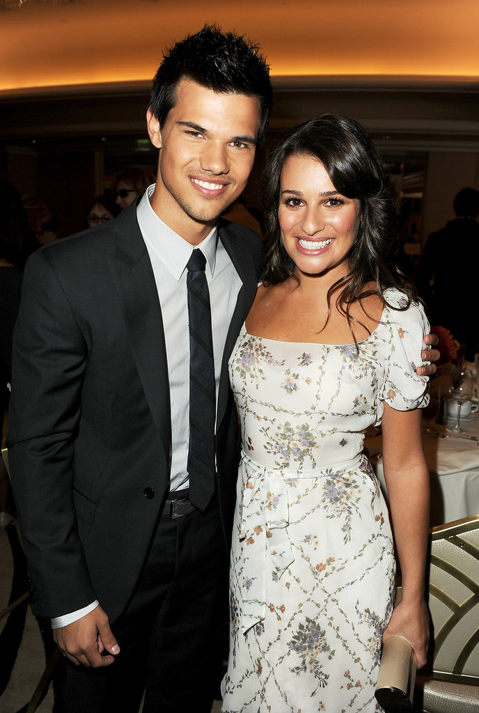 Lea sported a huge grin while posing with Taylor Lautner at a Hollywood Foreign Press luncheon in LA in August 2011.