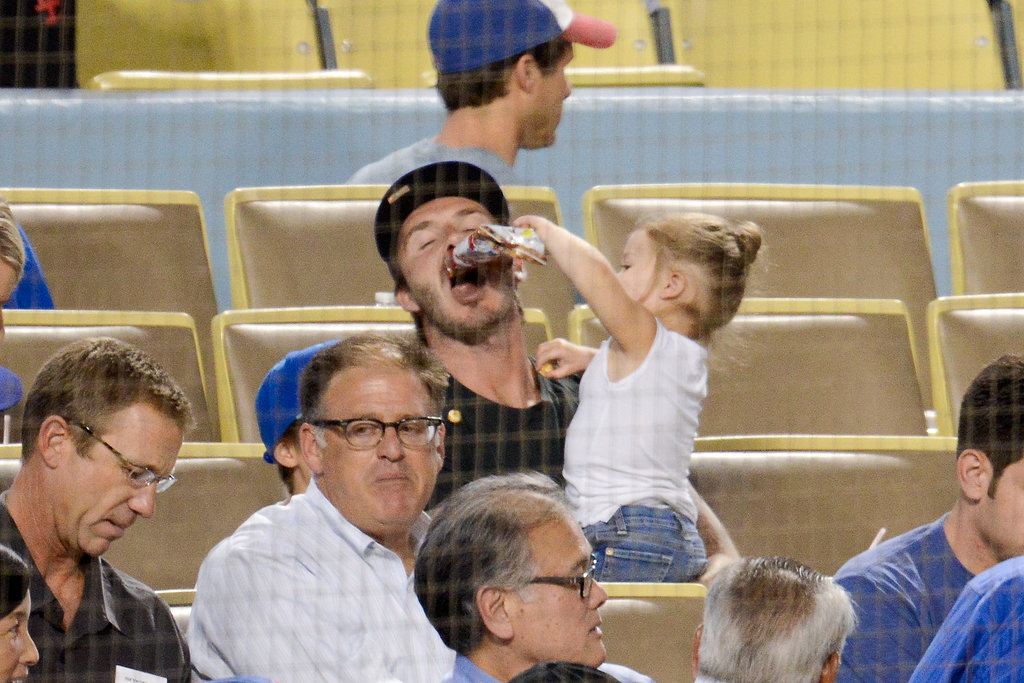 Harper Beckham fed her dad a snack during the game.