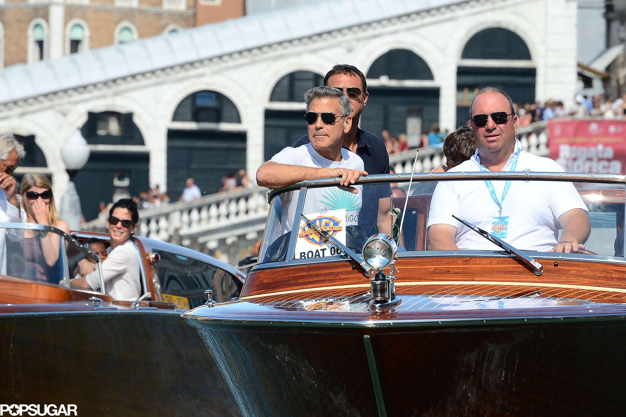 George Clooney and Sandra Bullock took boats to the Venice Film Festival.