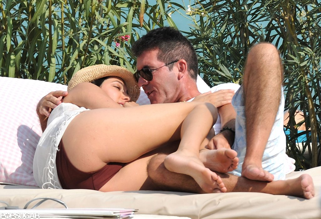 Simon Cowell and Lauren Silverman lounged on the beach together.