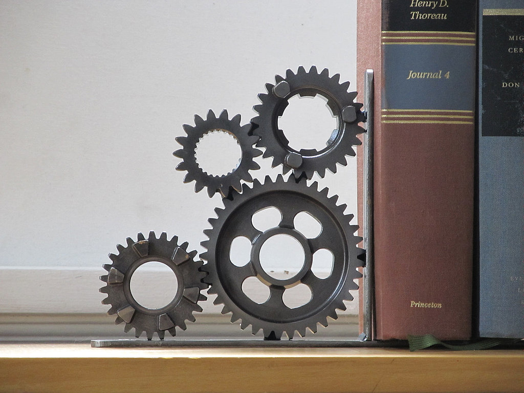 crafted of motorcycle transmission gears this four gear bookend cover to cover the geekiest. Black Bedroom Furniture Sets. Home Design Ideas