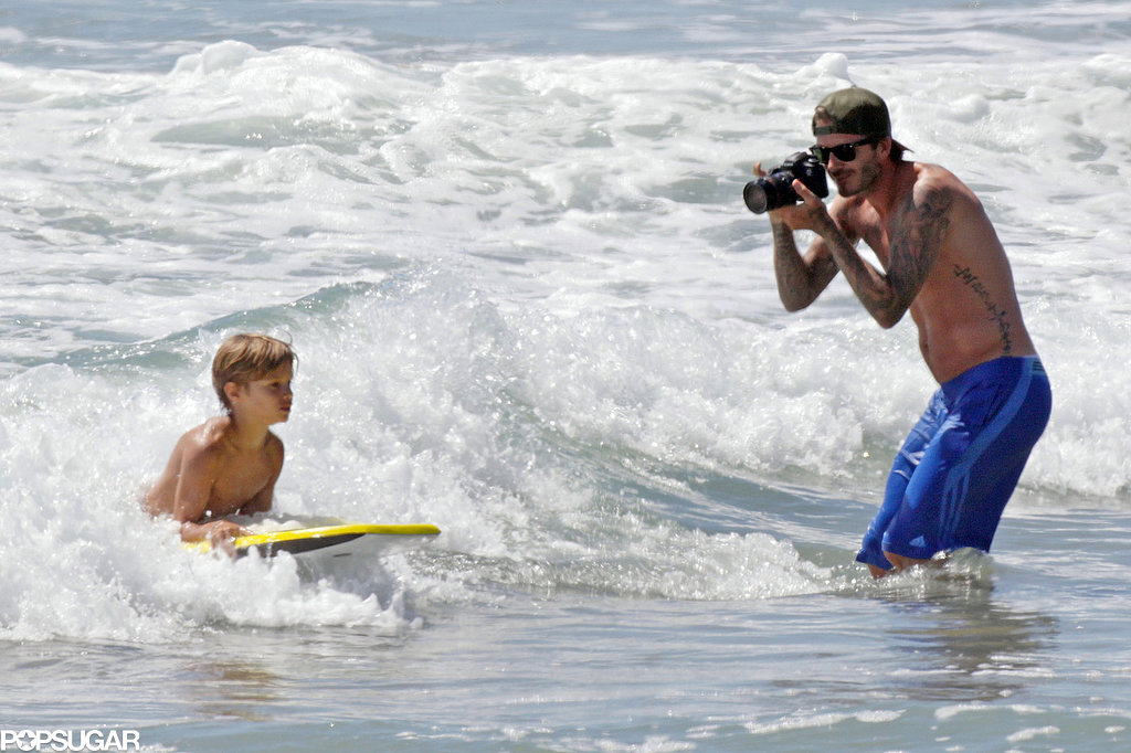 David Beckham photographed his son as he hit the waves in LA.
