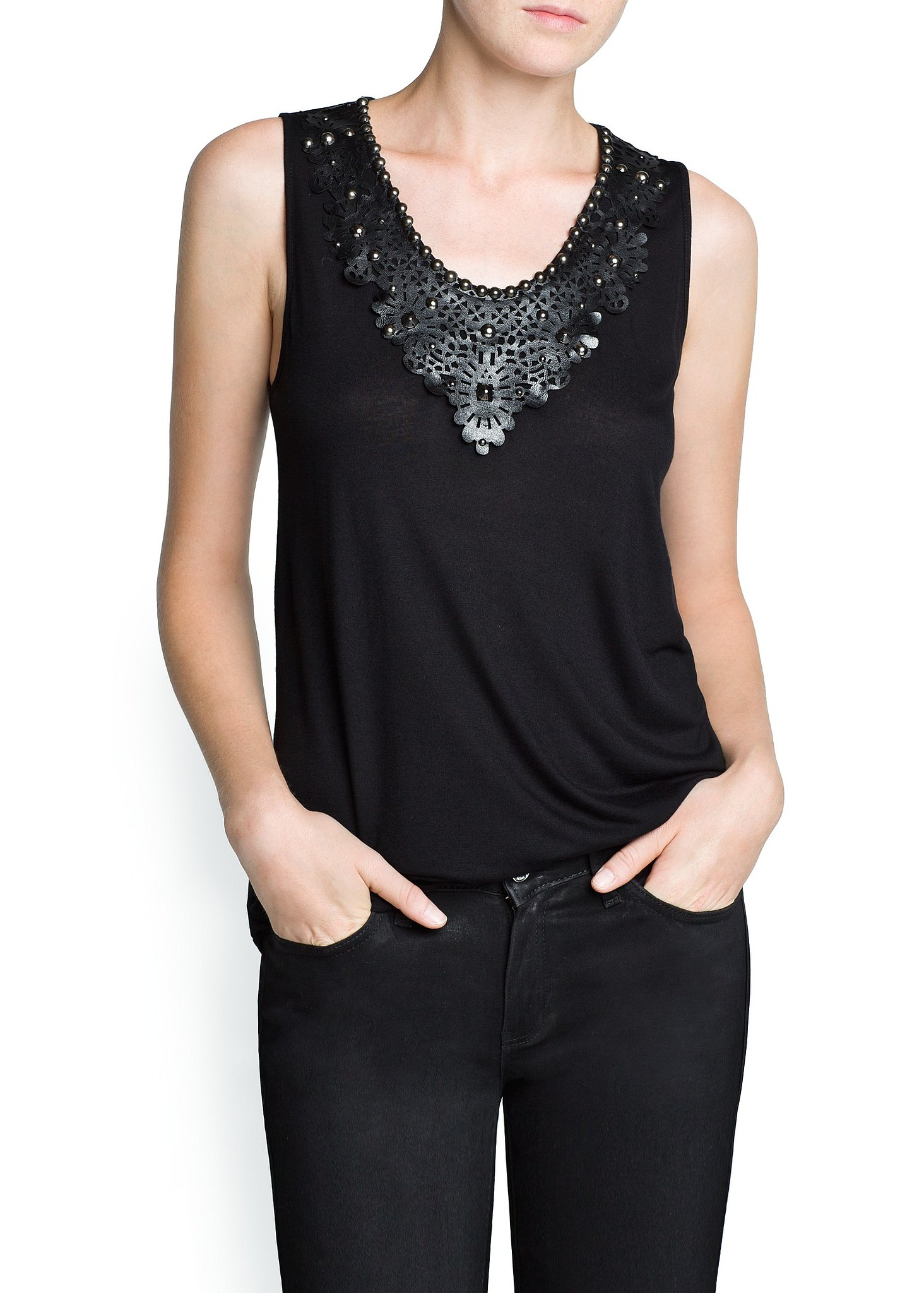 A touch of leather can add a luxe feel to basics. This Mango tank ($35) is far from simple thanks