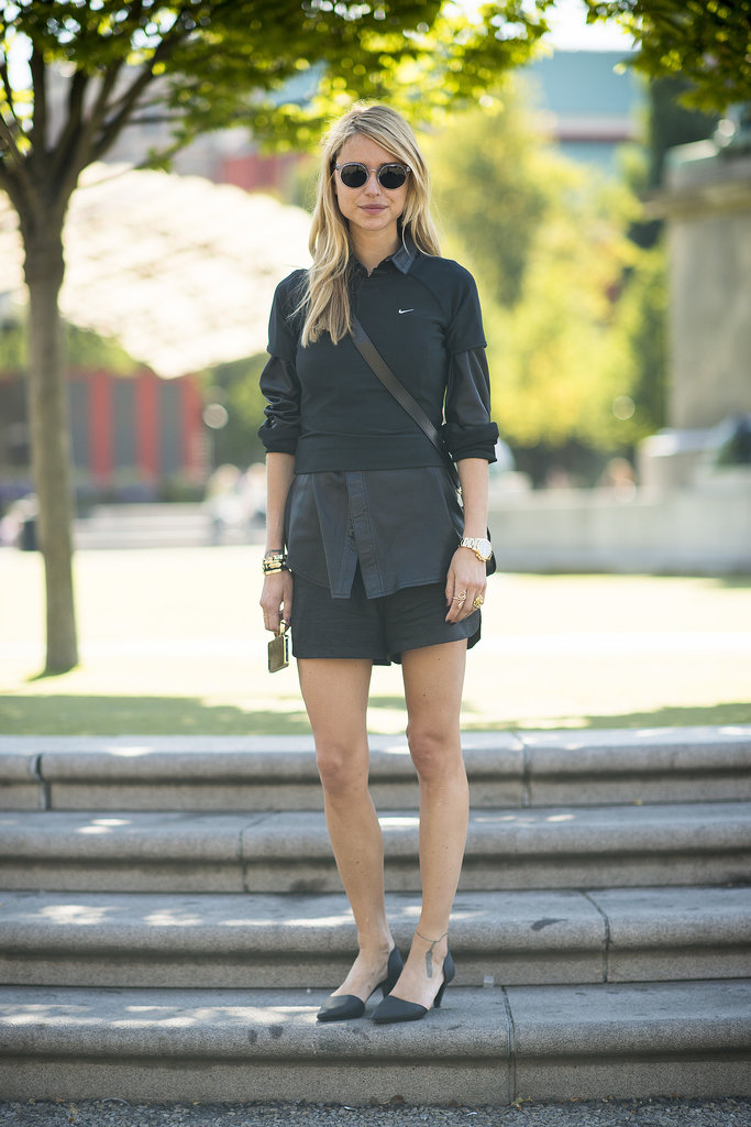 Yes, that's an athletic tee layered up over her button-down — and it totally works. Source: Le 21ème | Adam Katz Sinding