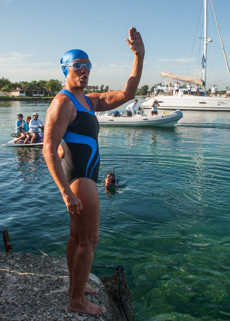 Diana Nyad gave a wave before beginning her long journey in the water.