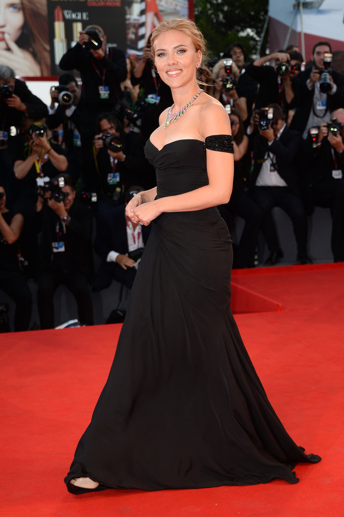 Scarlett Johansson wore a black Versace gown at the Venice Film Festival.
