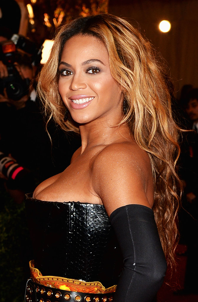At the Met Gala in May, Beyoncé showed off her signature glowing skin. She styled her hair in long, cascading curls and did her eyes in a smoldering smoky shadow.
