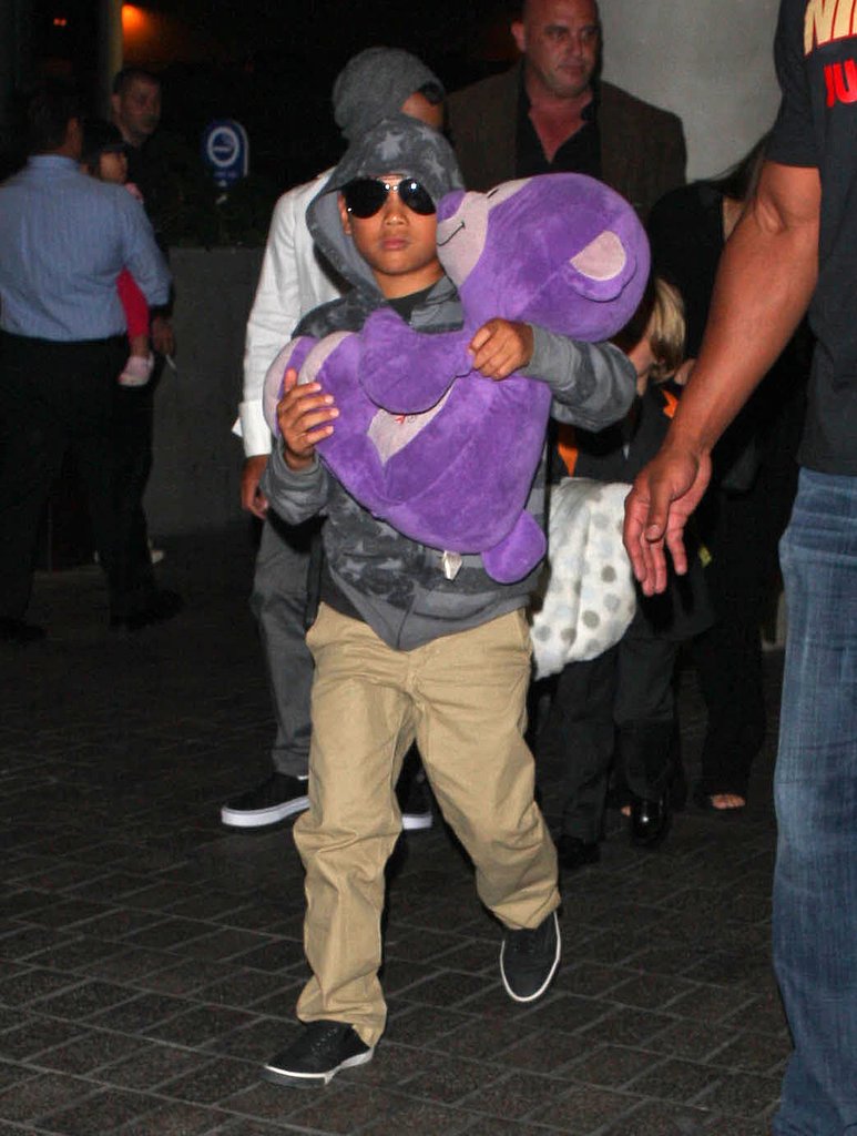 Pax carried his purple bear.