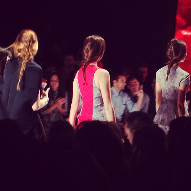 We're obsessed with the ease of these tousled french braids at the Project Runway show!