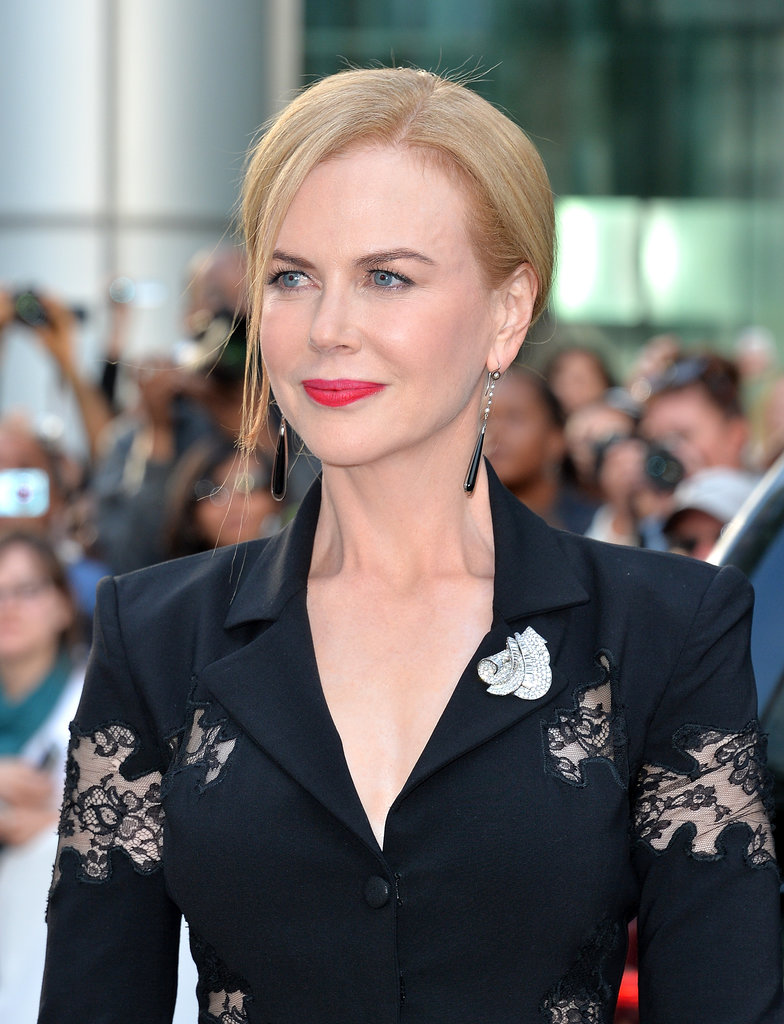 Nicole Kidman wore a bright red-orange lip look while attending the premiere of The Railway Man in Canada.