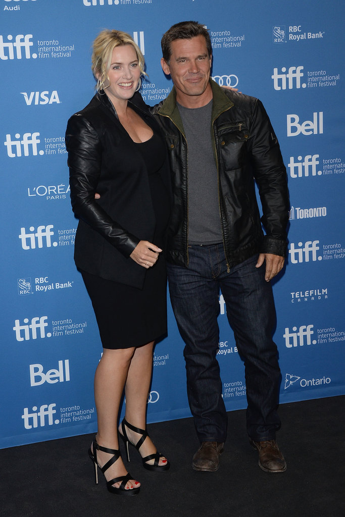 Kate Winslet and Josh Brolin posed together at the Labor Day press conference.