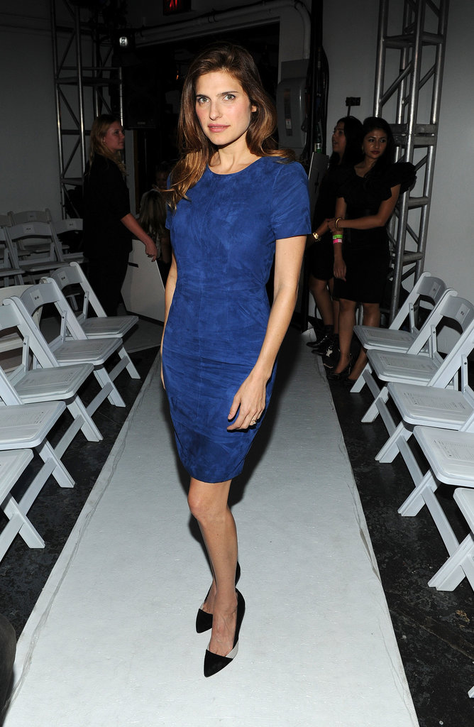 Lake Bell matched a blue short-sleeved minidress with black pumps for her Altuzarra appearance.