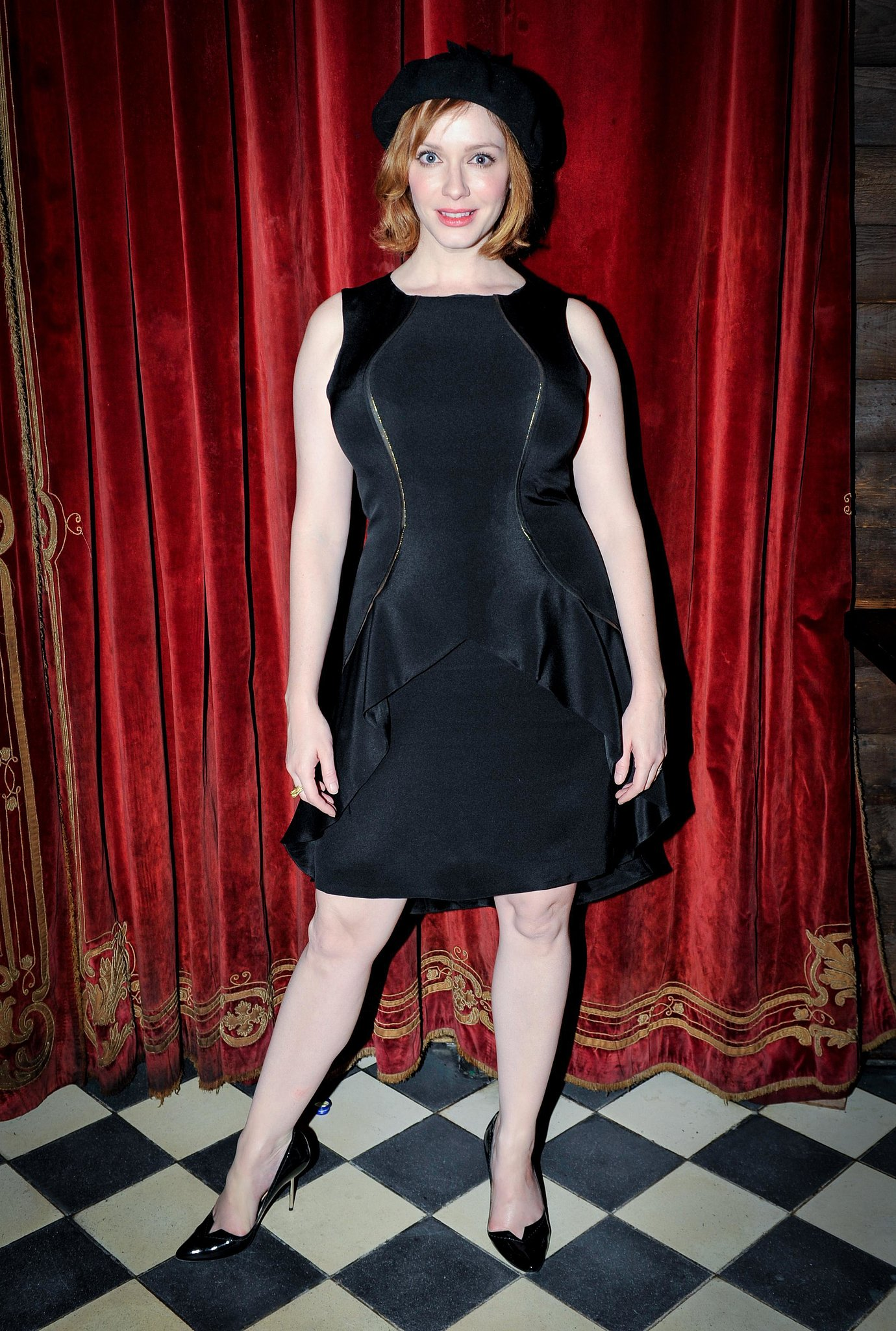 Christina Hendricks added a touch of Parisian chic to her black look via a black beret at Christian Siriano's afterparty.
