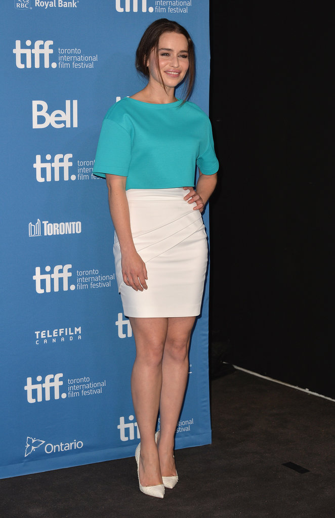 Emilia Clarke paired a turquoise crop top with a white high-waisted skirt and matching pumps at the Dom Hemingway press conference.