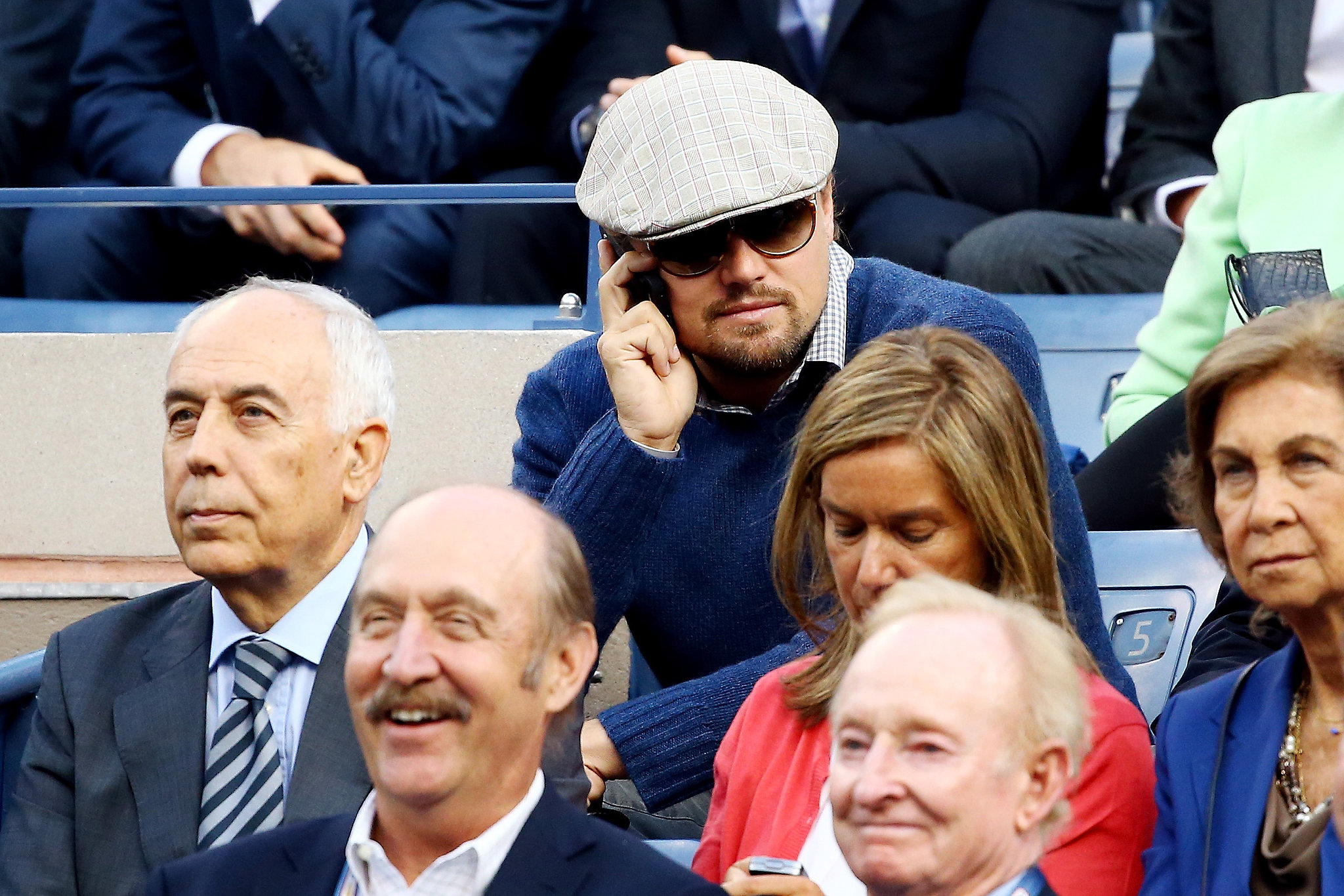 Leonardo DiCaprio took a quick call during the US Open.