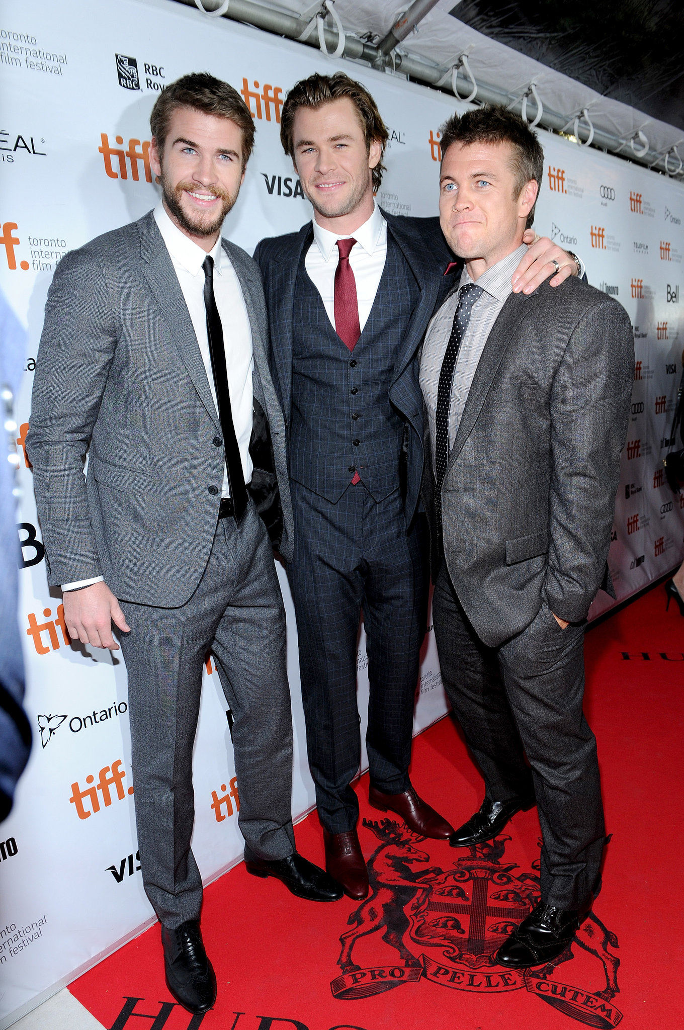 It was a blue-eyed trifecta as Liam Hemsworth, Chris Hemsworth, and Luke Hemsworth strolled the carpet.