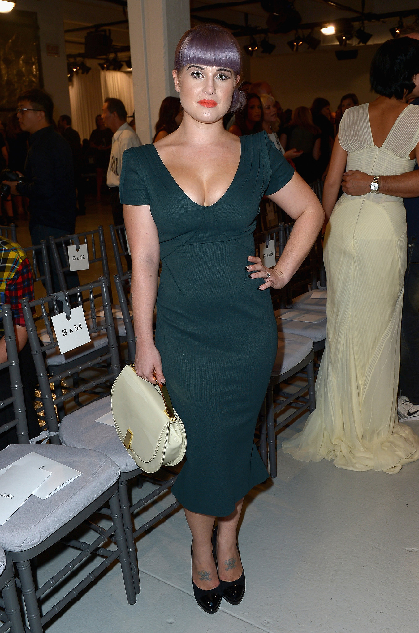 Kelly Osbourne put her figure front and center in a green formfitting shift dress at Zac Posen. A mint bag added a fun color contrast.