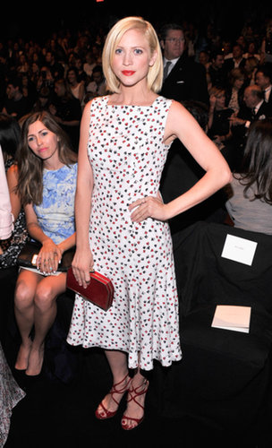 Brittany Snow's printed midi Jenny Packham dress coordinated perfectly with her red accessories at Carolina Herrera.