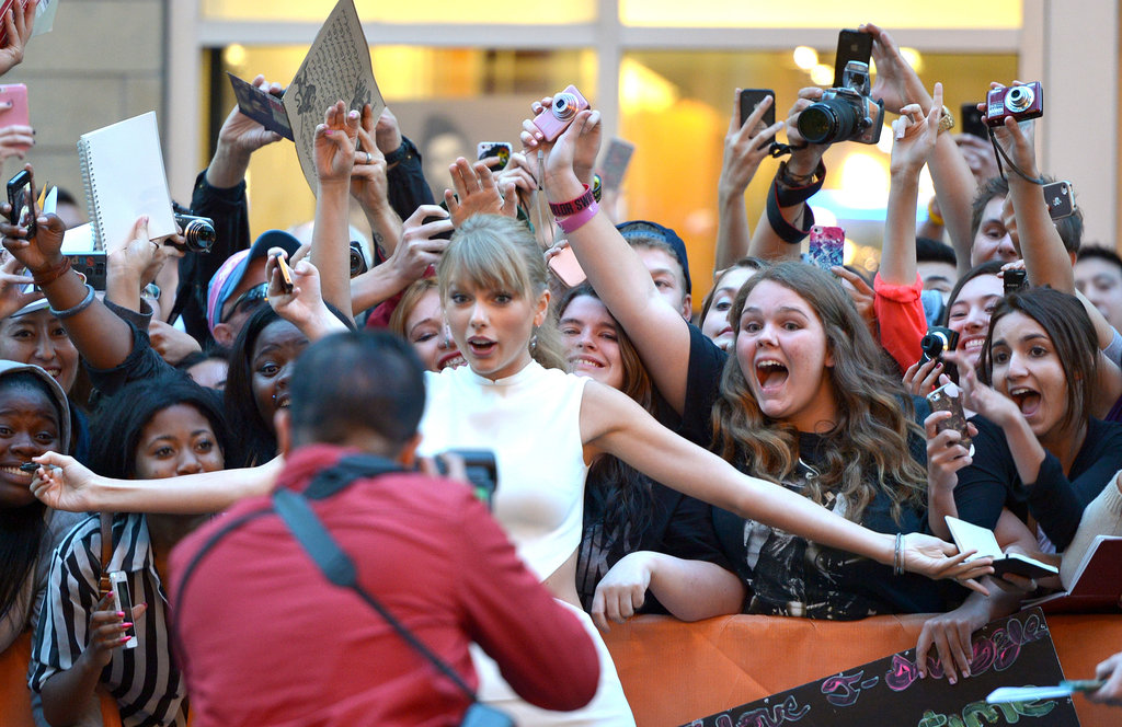 Taylor Swift posed with fans outside of the TIFF premiere of One Chance.
