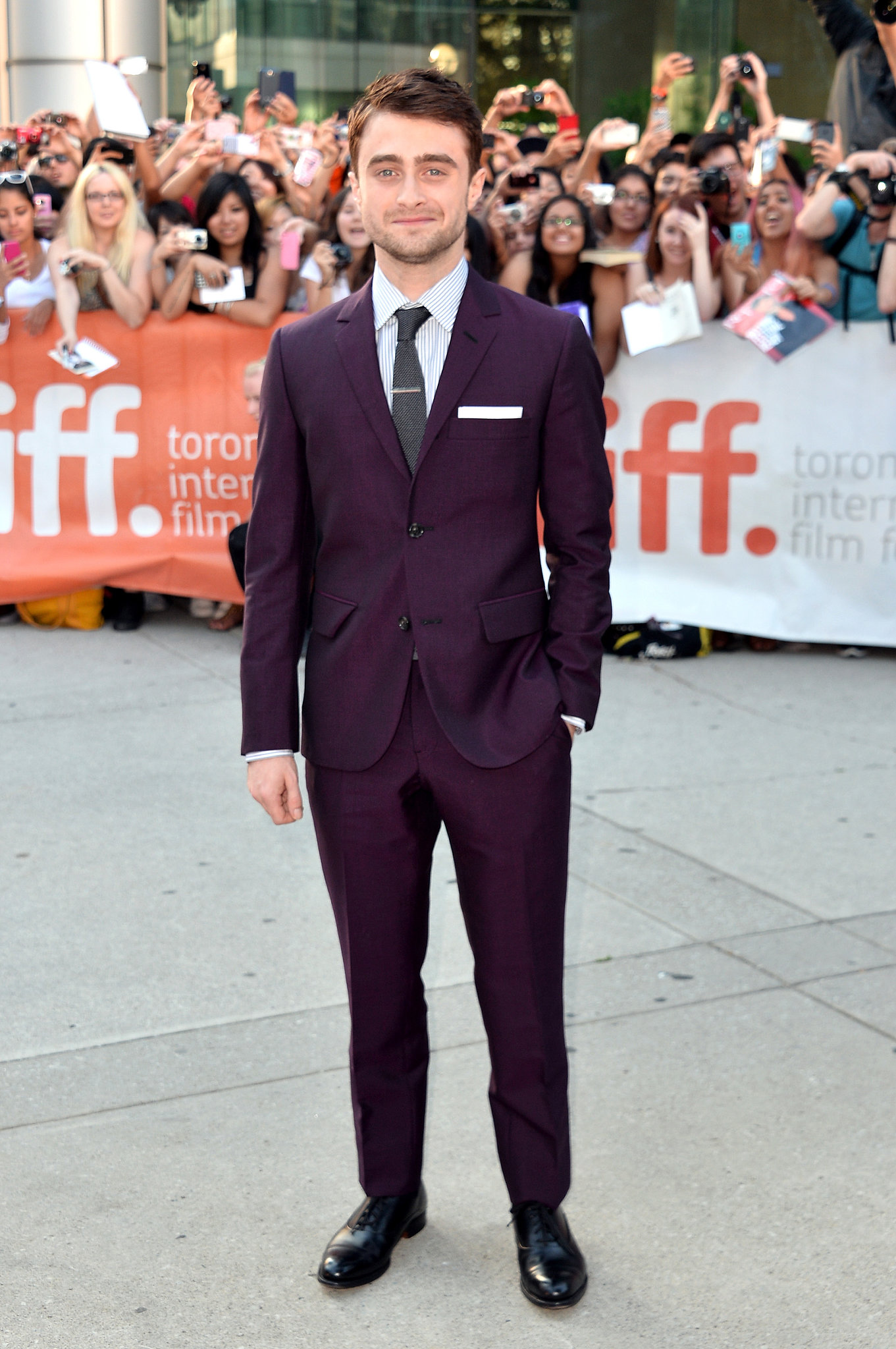 Daniel Radcliffe looked dapper in a maroon suit for the Kill Your Darlings premiere at TIFF.