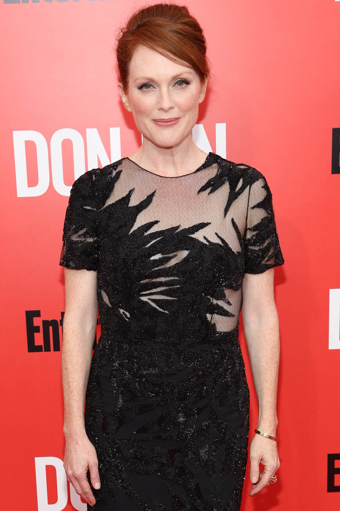Julianne Moore as President Alma Coin
