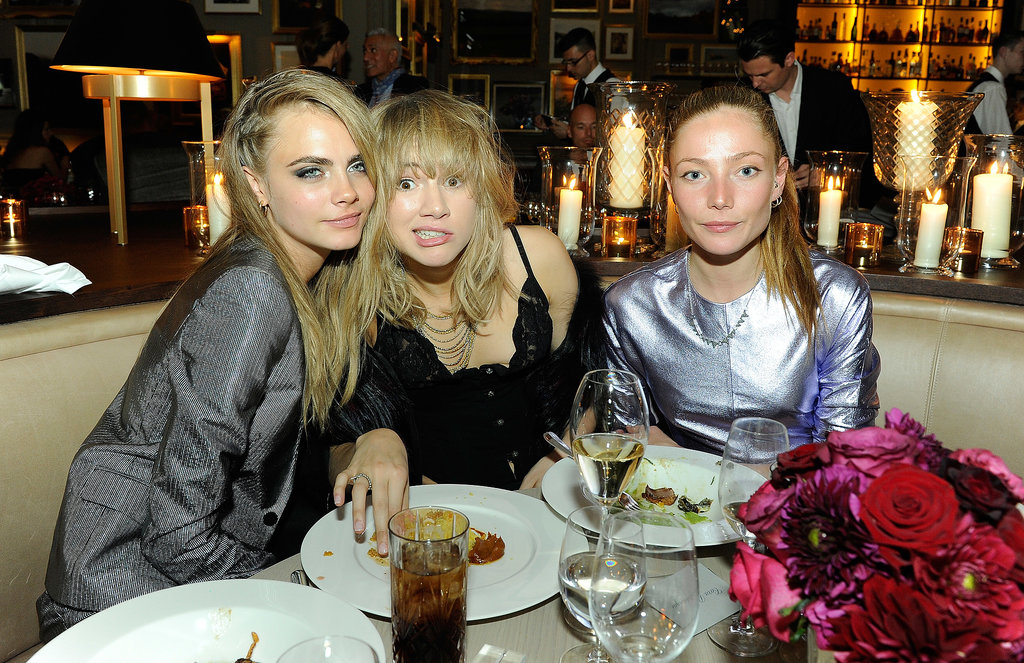 Cara Delevingne, Suki Waterhouse, and Ciara Paget got together at the W magazine party in London.