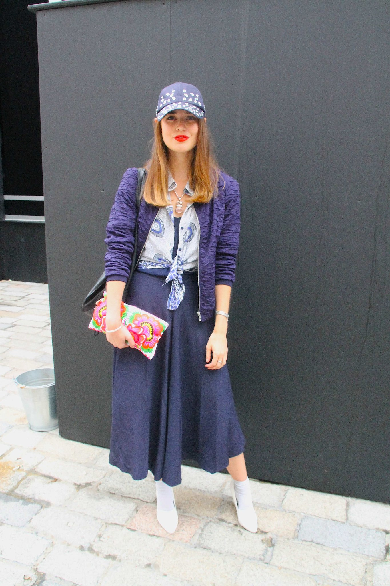 Sporty and sweet with a baseball cap, red lip, and pumps and socks. Source: Hannah Freeman