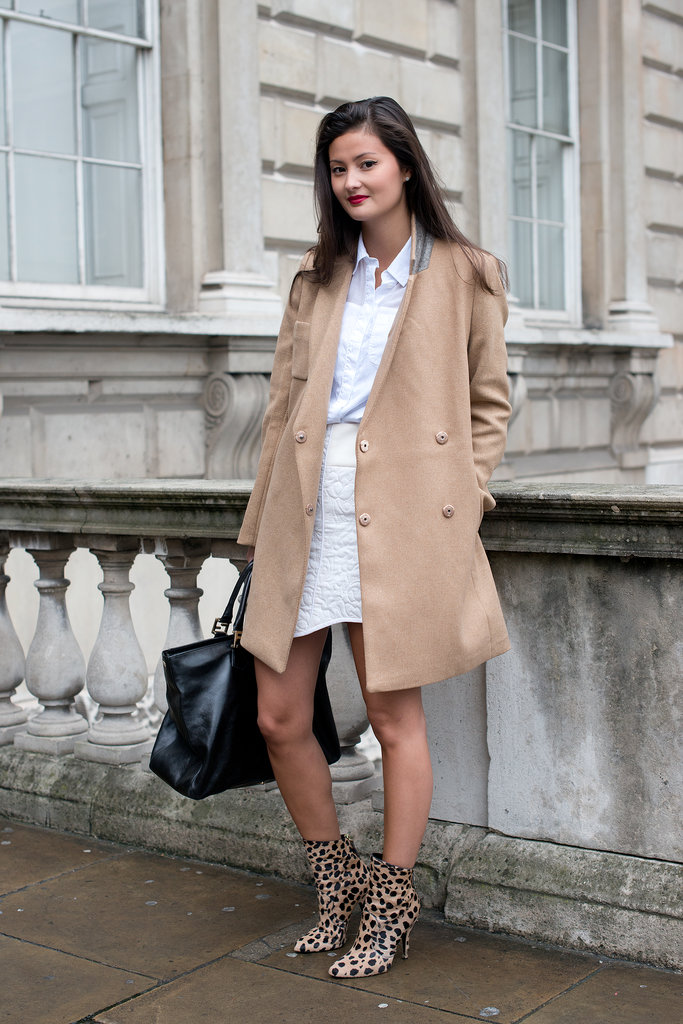 The camel coat — and those leopard print boots — made the look.