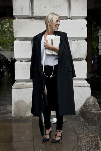 White and black, with only the best accessories, like her Proenza bag and Valentino heels.