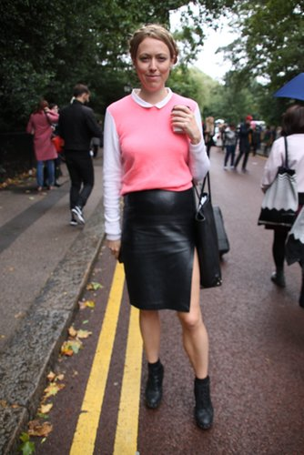 Demure up top, but with a little leather and a flash of leg, this look got a sexier spin on bottom. Source: Hannah Freeman