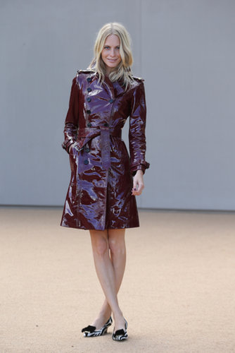 Poppy Delevingne was fittingly dressed in a trench at the Spring Burberry show.