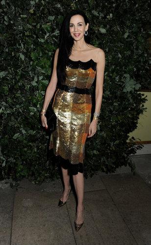 L'Wren Scott positively sparkled in her gold sequin design.